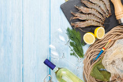 Fresh raw tiger prawns, spices and white wine. On wooden table with copy space Royalty Free Stock Photo
