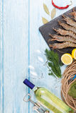 Fresh raw tiger prawns, spices and white wine. On wooden table with copy space Stock Image