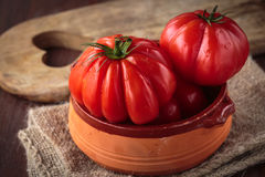 Fresh raw  tomatoes. Delicious fresh raw  tomatoes for an healthy meal Royalty Free Stock Photo