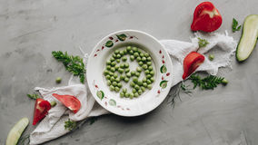 Fresh raw tomatoes on the table decorated with pieces of cucumbers and parsley. Fresh raw tomatoes on the table decorated with pieces of cucumbers and parsley Stock Image