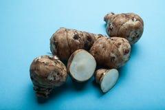 Fresh raw Topinambur or jerusalem artichoke on black background royalty free stock image