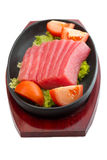 Fresh raw tuna fish pieces on plate isolated Royalty Free Stock Photography