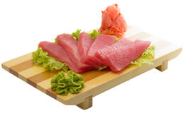 Fresh raw tuna fish pieces on plate isolated. Fresh raw tuna fish pieces with vegetables on plate isolated Stock Image