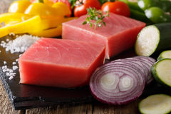 Fresh raw tuna steak with vegetable ingredients and spices close Stock Photography