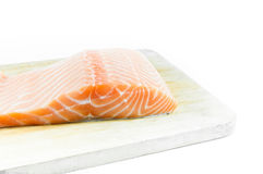 fresh raw uncooked salmon fish piece over wooden board Stock Photo
