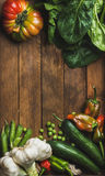 Fresh raw vegetable ingredients for healthy cooking or salad making on wooden background. Top view, copy space. Diet or vegetarian food concept Royalty Free Stock Photos