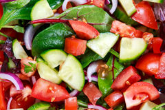 Fresh raw vegetable mixed salad. close up,  view from top Royalty Free Stock Photo