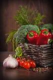 Fresh raw vegetables. Raw vegetables in wicker basket Stock Image