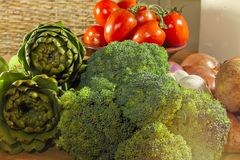 Fresh Raw Vegetables. Close-up. Variety of fresh raw organic vegetables on kitchen table Stock Images