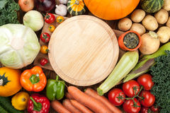 Fresh raw vegetables and cutting board. Top view Royalty Free Stock Images