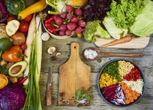 Fresh raw vegetables with cutting board on wooden background cop stock photos