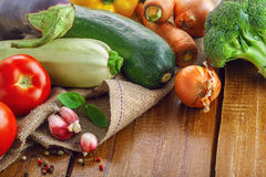 Fresh raw vegetables harvest. Fresh raw vegetables on a canvas plain. Ingredients for healthy food cooking Royalty Free Stock Photography