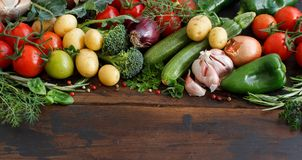 Fresh raw vegetables and herbs. On a wooden background Royalty Free Stock Photography