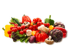 Fresh raw vegetables and herbs  on white. Background. food ingredients. tomato, paprika, artichoke, mushrooms, cucumber, green salad, garlic Stock Photography