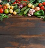 Fresh raw vegetables and herbs. On a wooden background Stock Image