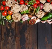 Fresh raw vegetables and herbs. On a wooden background Stock Images