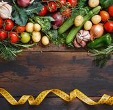 Fresh raw vegetables and herbs. On a wooden background Stock Photo