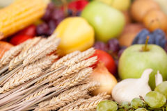 Fresh raw vegetables. Fresh mix of vegetables and wheat on the wooden table Royalty Free Stock Image