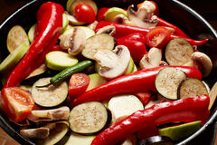 Fresh raw vegetables mushrooms and red paprika, eggplant, vegetable marrow, tomato Royalty Free Stock Images
