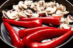 Fresh raw vegetables mushrooms and red paprika. For healthy lunch Stock Image
