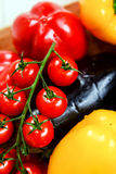 Fresh Raw Vegetables. Plum baby tomatoes, pepper, paprika, onion, courgettes, eggplant Royalty Free Stock Image