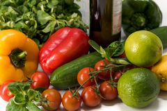 Fresh raw vegetables for the preparation of vegetarian meals. Fresh raw vegetables, salad preparation, pepper tomatoes cucumber fresh salad lime lemon cheese Stock Photo
