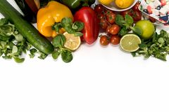 Fresh raw vegetables for the preparation of vegetarian meals. Fresh raw vegetables, salad preparation, pepper tomatoes cucumber fresh salad lime lemon cheese Royalty Free Stock Images