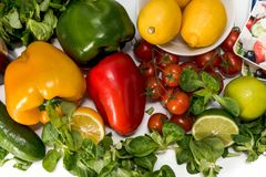 Fresh raw vegetables for the preparation of vegetarian meals. Fresh raw vegetables, salad preparation, pepper tomatoes cucumber fresh salad lime lemon cheese Stock Images