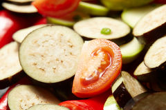 Fresh raw vegetables red paprika, eggplant, vegetable marrow, tomato. For healthy lunch Stock Photo