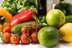 Fresh raw vegetables for the preparation of vegetarian meals. Fresh raw vegetables, salad preparation, pepper tomatoes cucumber fresh salad lime lemon cheese Stock Image