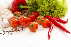 Fresh raw vegetables spices on a wooden table Stock Image
