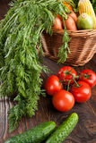 Fresh raw vegetables. On the table and in a basket Royalty Free Stock Images
