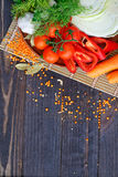 Fresh, raw vegetables on the table. Fresh, raw vegetables on the dark wooden table Royalty Free Stock Photography