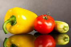 Fresh raw vegetables. Tomato, zucchini and pepper on the table Royalty Free Stock Photo