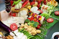 Fresh raw vegetables. Fresh vegetable and skewers for BBQ on buffet restaurant Royalty Free Stock Photography