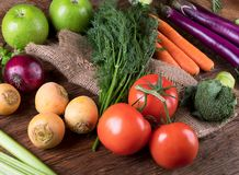Fresh raw vegetables on wooden background. Bio Healthy food concept.Top view Stock Photos