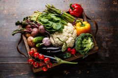 Fresh raw vegetables in wooden box. On wooden background Stock Image