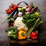 Fresh raw vegetables in wooden box. On wooden background Stock Photography