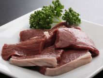 Fresh raw Wagyu salt hearts of beef with herbs on white platter. Deliciously Royalty Free Stock Image