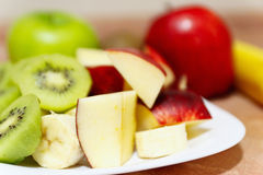 Fresh raw whole and sliced apple and kiwi closeup Royalty Free Stock Photos