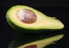 Fresh ready to eat avocado fruit on black background Royalty Free Stock Photos