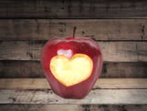 Fresh red apple. On wood background Royalty Free Stock Photo
