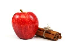 Fresh red apple and cinnamon sticks. Fresh red apple and cinnamon sticks isolated on white background Stock Photos