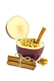 Fresh red apple filled with walnut, honey and cinnamon isolated on white Royalty Free Stock Photo
