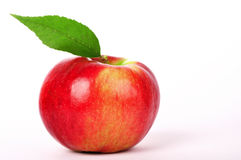 Fresh red apple with green leaf isolated on white Royalty Free Stock Photography