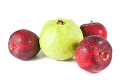 Fresh red apple and  guava. On white Royalty Free Stock Photos
