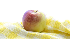 Fresh red apple healthy fruit on yellow table mat Stock Photos