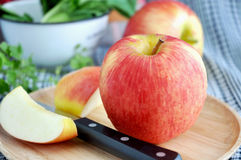 Fresh red apple on tray. Fresh red apple on wooden tray with knife Royalty Free Stock Image