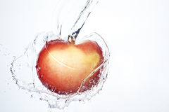 Fresh red apple underwater Stock Photos