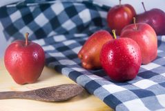 Fresh red apple on wooden table. Apples are extremely rich in important antioxidants, flavanoids, and dietary fiber royalty free stock images
